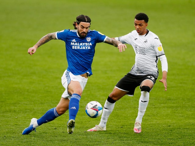 Swansea City's Morgan Whittaker in action with Cardiff City's Marlon Pack in the Championship on March 20, 2021