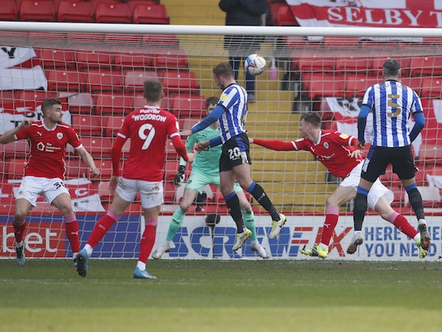 Sheffield Wednesday's Jordan Rhodes scores their first goal  against Barnsley on March 20, 2021