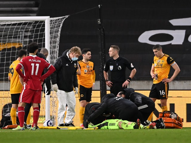 Wolverhampton Wanderers goalkeeper Rui Patricio receives medical attention against Liverpool on March 15, 2021