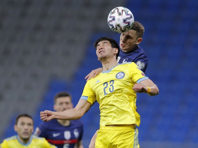 France's Lucas Digne in action with Kazakhstan's Marat Bystrov on March 28, 2021