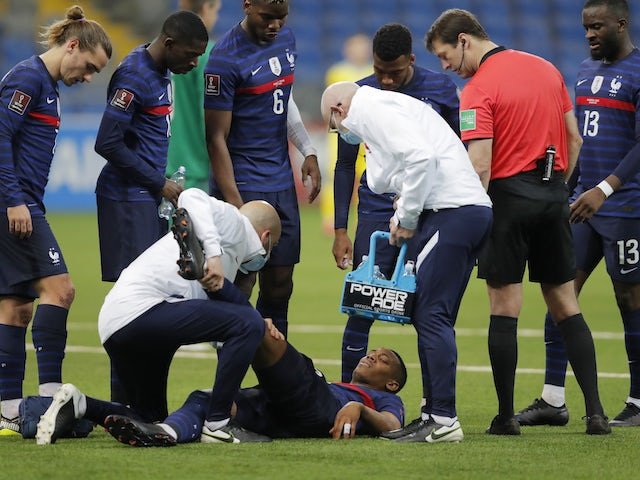 France's Anthony Martial receives medical attention on March 28, 2021