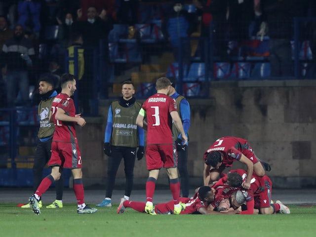 Armenia's Tigran Barseghyan celebrates scoring their first goal with teammates on March 28, 2021
