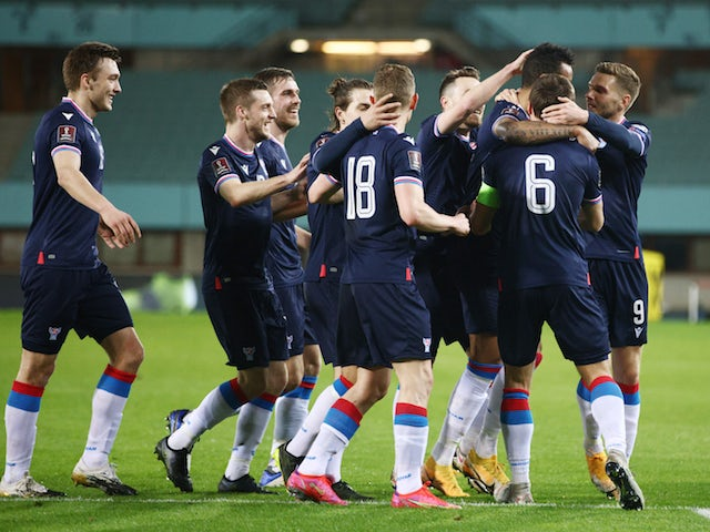 Faroe Islands' Sonni Nattestad celebrates scoring their first goal with teammates on March 28, 2021