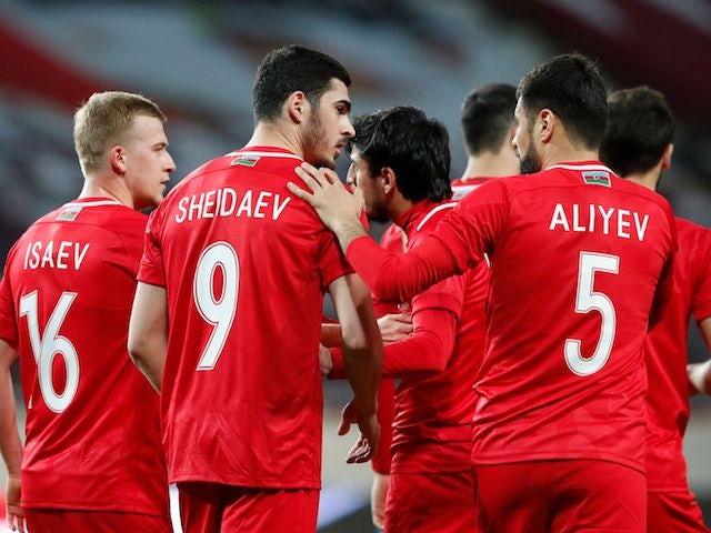 Azerbaijan's Ramil Sheydaev celebrates scoring their first goal with teammates on March 27, 2021