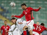 Bulgaria's Daniel Dimov in action with Italy's Andrea Belotti on March 28, 2021