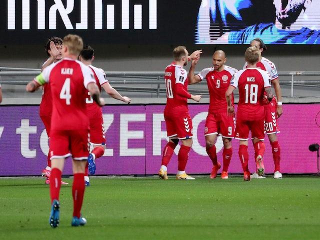 Denmark's Martin Braithwaite celebrates scoring their first goal with teammates on March 25, 2021