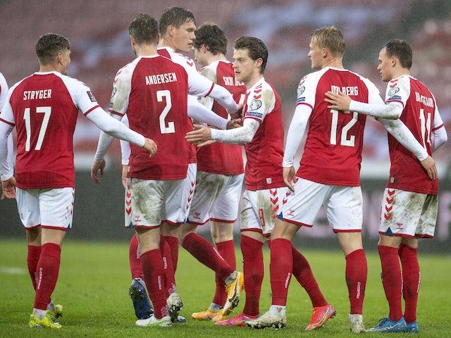 Denmark's Mathias Jensen celebrates scoring their fifth goal with teammates on March 28, 2021