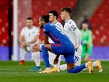 England's Dominic Calvert-Lewin takes a knee on March 25, 2021
