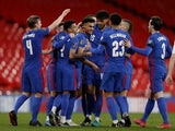 England's Ollie Watkins celebrates scoring their fifth goal with teammates on March 25, 2021