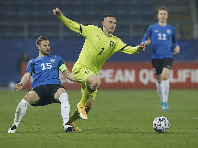 Estonia's Rauno Sappinen in action with Czech Republic's Pavel Kaderabek on March 24, 2021