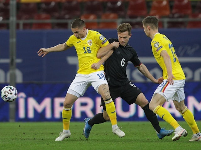 Germany's Joshua Kimmich in action with Romania's Razvan Marin on March 28, 2021