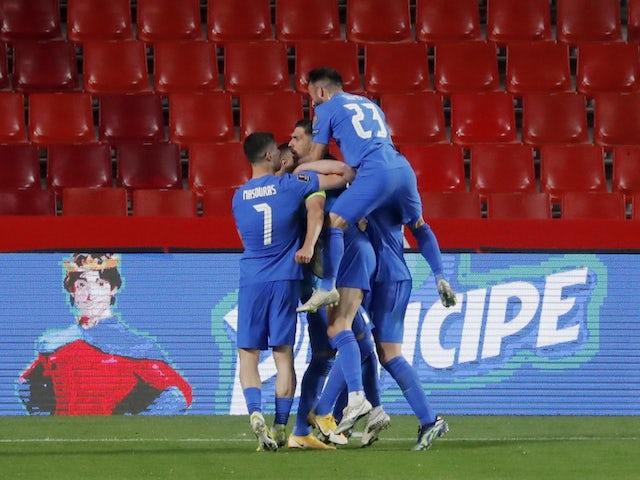 Greece's Anastasios Bakasetas celebrates scoring his first goal with teammates on March 25, 2021