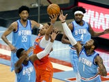 Oklahoma City Thunder center Moses Brown reaches for a rebound against the Houston Rockets on March 21, 2021