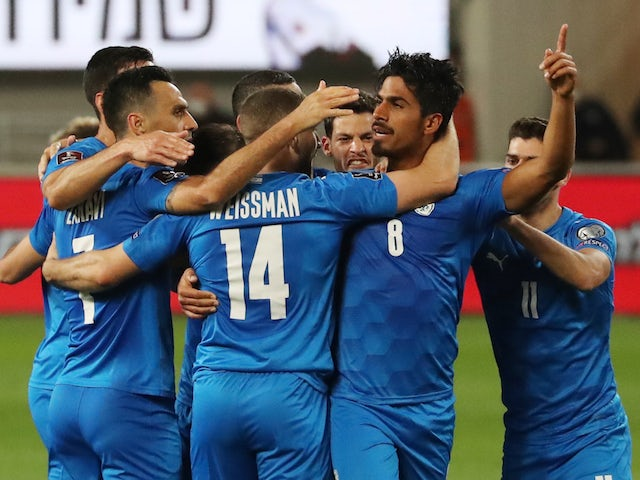 Israel's Dor Peretz celebrates scoring their first goal with teammates on March 28, 2021