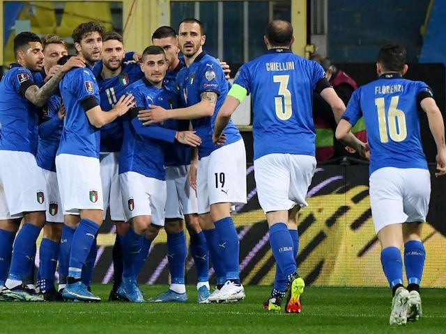 Italy's Domenico Berardi celebrates scoring their first goal with teammates on March 25, 2021