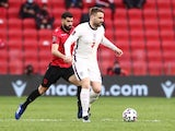 England's Luke Shaw in action with Albania's Elseid Hysaj on March 28, 2021