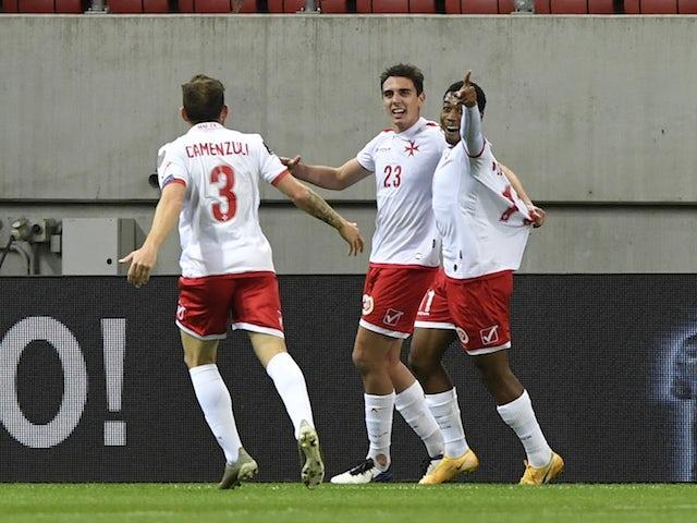 Malta's Alexander Satariano celebrates scoring their second goal with teammates on March 27, 2021