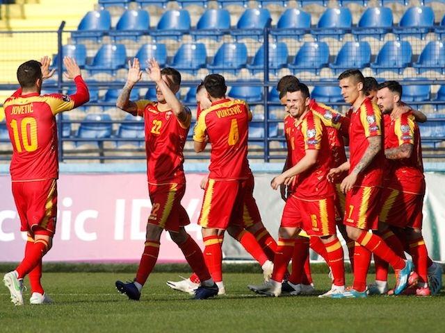 Montenegro's Zarko Tomasevic celebrates scoring their third goal with teammates on March 27, 2021