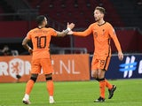 Netherlands' Luuk de Jong celebrates scoring their second goal with Memphis Depay on March 27, 2021