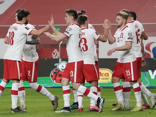 Poland's Robert Lewandowski celebrates scoring their first goal with teammates on March 28, 2021