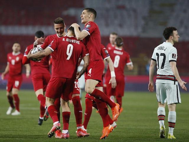 Serbia's Aleksandar Mitrovic celebrates scoring their first goal with teammates on March 27, 2021