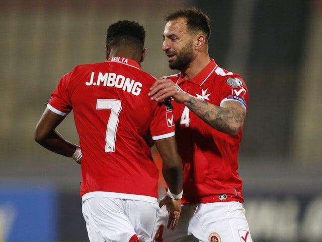 Malta's Joseph Mbong celebrates scoring against Russia on March 24, 2021