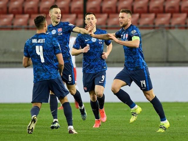 Slovakia's Milan Skriniar celebrates scoring their second goal with teammates on March 27, 2021