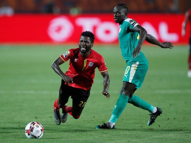 Uganda's Allan Kyambadde in action with Senegal's Sadio Mane in July 2019