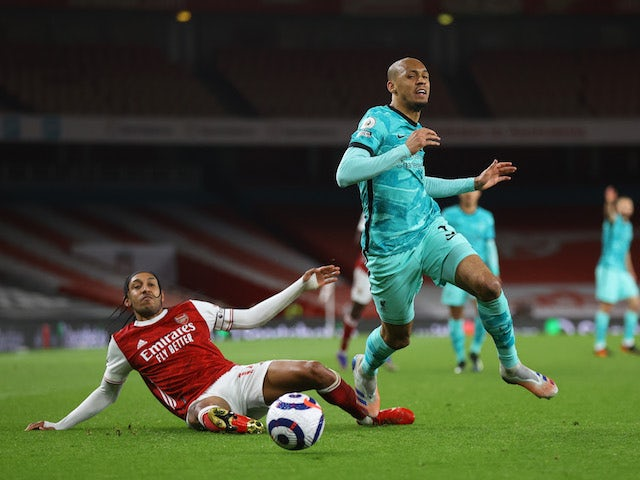 Arsenal's Pierre-Emerick Aubameyang in action with Liverpool's Fabinho in the Premier League on April 3, 2021