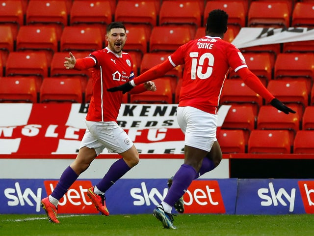 Barnsley's Alex Mowatt celebrates scoring their first goal against Reading in the Championship on April 2, 2021