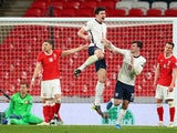 England's Harry Maguire celebrates scoring against Poland on March 31, 2021