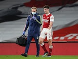 Kieran Tierney limps off injured during Arsenal's game against Liverpool in the Premier League on April 3, 2021