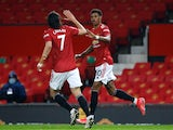 Manchester United's Marcus Rashford celebrates scoring their first goal against Brighton & Hove Albion in the Premier League on April 4, 2021