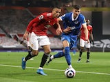 Manchester United's Mason Greenwood in action with Brighton & Hove Albion's Jakub Moder in the Premier League on April 4, 2021