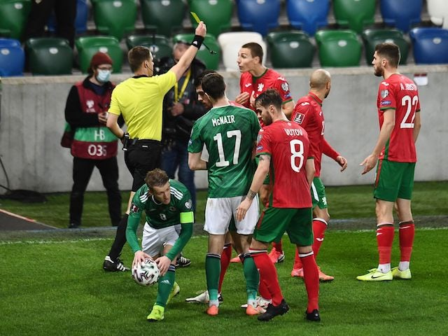 Bulgaria's Valentin Antov is shown a yellow card during the clash with Northern Ireland on March 31, 2021