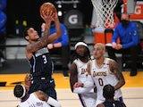 Orlando Magic forward Chuma Okeke shoots over Los Angeles Lakers center Montrezl Harrell on March 29, 2021
