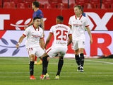 Sevilla's Marcos Acuna celebrates scoring against Atletico Madrid on April 4, 2021