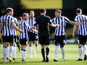 Sheffield Wednesday's Josh Windass remonstrates with referee Chris Kavanagh after Tom Lees scored an own goal against Watford in the Championship on April 2, 2021
