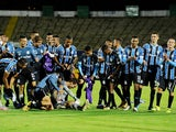 Gremio players celebrate after the match on March 17, 2021
