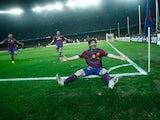 Barcelona's Lionel Messi celebrates after scoring his goal against Arsenal on April 6, 2010