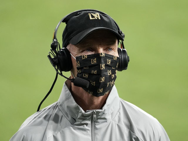 Los Angeles FC (LAFC) coach Bob Bradley wears a face mask during a game against the Houston Dynamo at Banc of California Stadium in October 2020