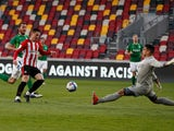Brentford's Sergi Canos and Birmingham's Neil Etheridge in action in the Championship on April 6, 2021
