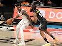 New York Knicks forward Julius Randle dribbles the ball against Brooklyn Nets guard James Harden on April 5, 2021