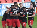 DC United celebrate their second goal in the first half against the Montreal Impact at Audi Field in November 2020