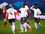 France's Viviane Asseyi celebrates scoring their second goal against England on April 9, 2021