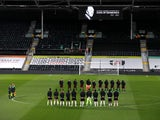Fulham and Wolverhampton Wanderers players observe a period of silence following Prince Philip's death on April 9, 2021