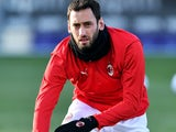 Hakan Calhanoglu warms up for Milan on March 21, 2021