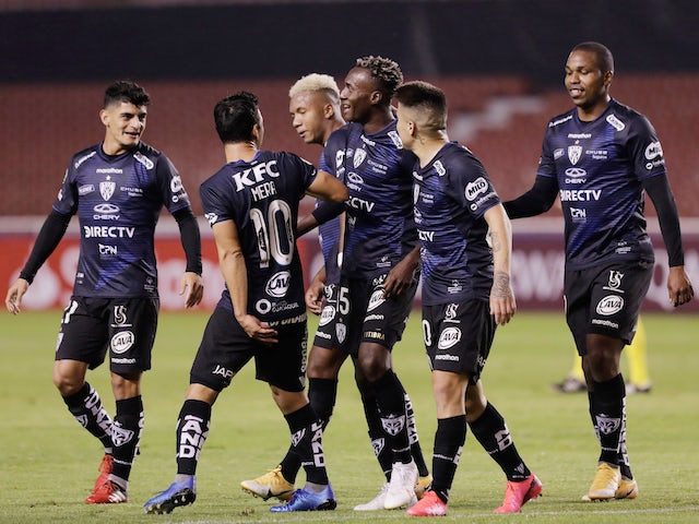 Independiente del Valle's Beder Caicedo celebrates scoring their fifth goal with teammates in September 2020