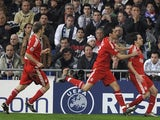 Liverpool's Yossi Benayoun (R) celebrates his goal during their Champions League soccer match against Real Madrid at Santiago Bernabeu stadium in Madrid February 25, 2009