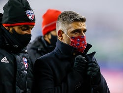 FC Dallas head coach Luchi Gonzalez adjusts his coat at half time of a game against the Seattle Sounders FC at Lumen Field in December 2020
